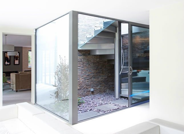 Internal glass 'box' housing staircase to external terrace in refurbished house in Cheltenham
