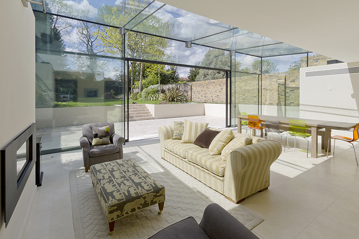 The expansive glazing opens to connect the interior and exterior spaces seamlessly.