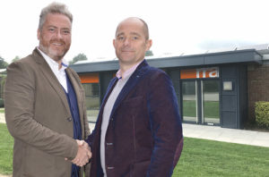 New director, Jonathan White, shakes hands with RRA Managing Director, Mark Powles, outside the new Elmbridge Court Business Park office.
