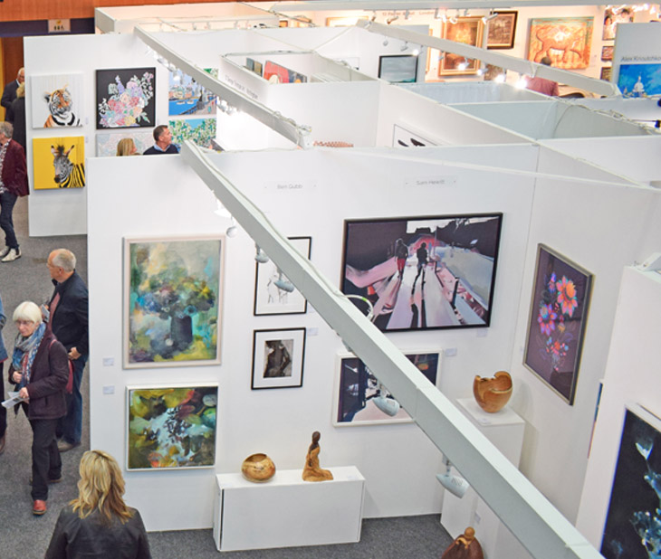 Visitors and art on display at the Private View of Fresh: Art Fair 2019 at Cheltenham Racecourse.