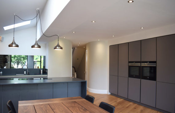 Contemporary kitchen extension with curved walls to link to the rest of the house.