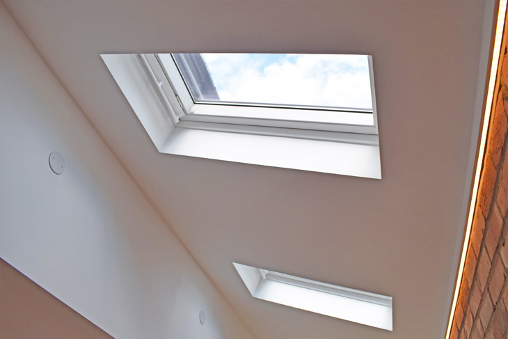 Rooflights add extra illumination in the kitchen area.