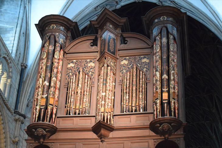 Gloucester Cathedral contains the surviving complete 17th century cathedral organ, shown here in the evening light.