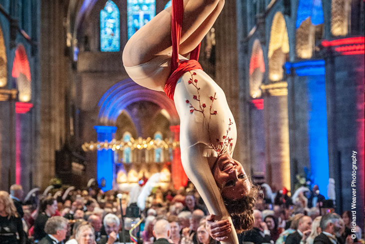 Francesca Carlson of Wye Circus CIC performs at Hereford Cathedral Nave Dinner. Photograph credit: Richard Weaver Photography