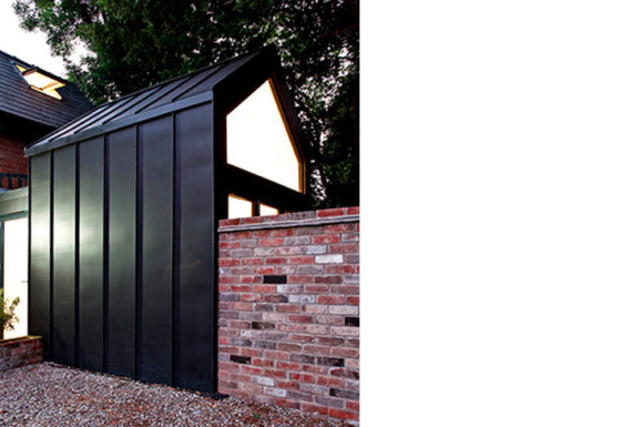 A contemporary extension to a small coach house.