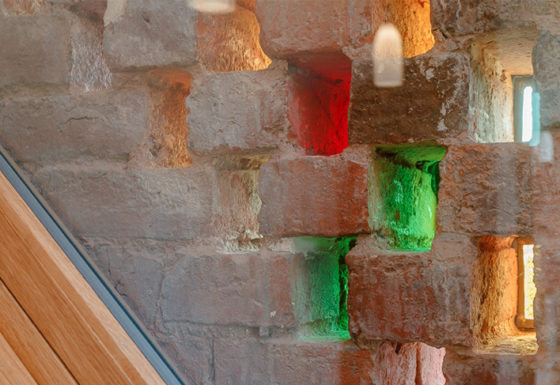Original 'hit and miss' brickwork re-used with the creative use of coloured glass.