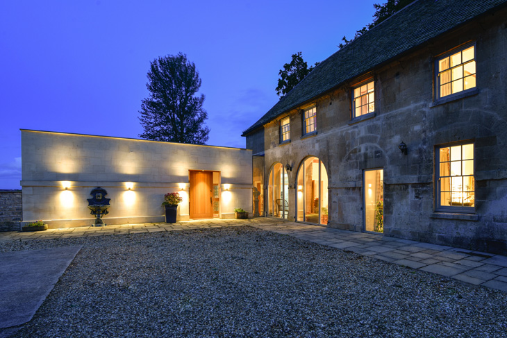 Contemporary extension to curtilage listed coach house in the Cotswolds