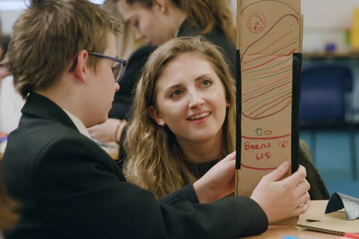 RRA Architects, Chanel Goodman, helps a student at the 'Get A Proper Job' workshop