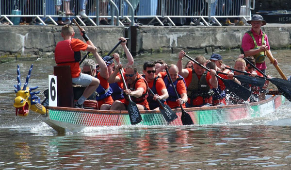 Taking part in a the Dragonboat Race at Gloucester Docks in aid of the Pied Piper Appeal