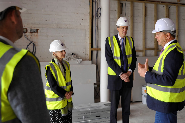 Phil Brace, Chief Executive of The Little Princess Trust, gives the Lord-Lieutenant to Herefordshire, Edward Harley, and his wife Victoria a tour of The Hannah Tarplee building as work progresses on the charity's new headquarters.