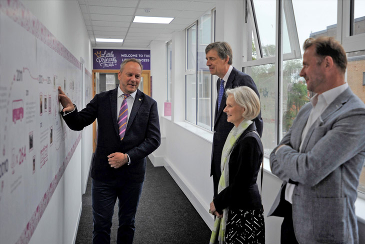 Phil Brace, Chief Executive of The Little Princess Trust, explains the history of the charity to the Lord-Lieutenant to Herefordshire, Edward Harley, his wife Victoria and Deputy Lieutenant William Lindesay.