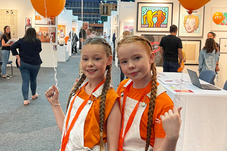 RRA helpers, Poppy and Itty Palmer-Powles hand out balloons at the art fair.