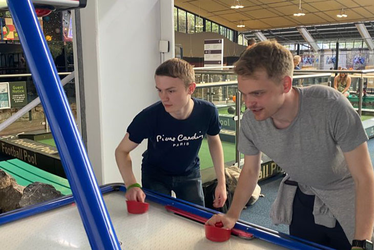 The air hockey was quite competitive when Ryan Birch and James Lovering teamed up.