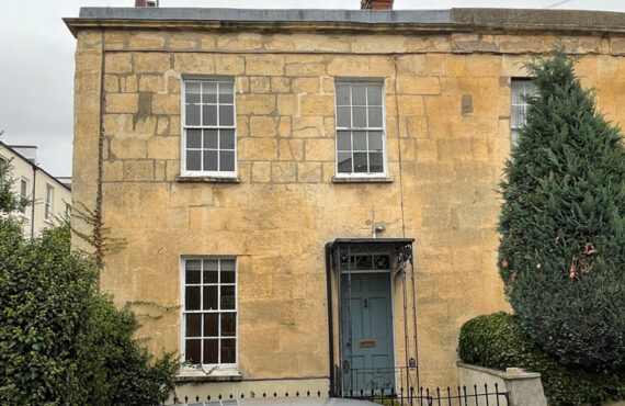 A Grade II Listed, ashlar stone facade; one of a pair of listed buildings of this period in Cheltenham's conservation area.